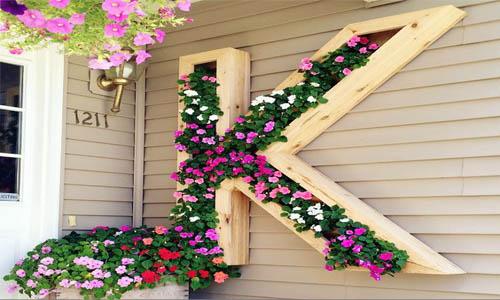 vườn hoa treo tường bằng ván ép phủ keo trong